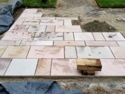 Cutting and laying paving slabs