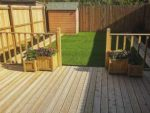 New fencing and decking in a garden