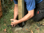 Fixing Fence Posts and Using Metal Post Holders for Securing Fencing
