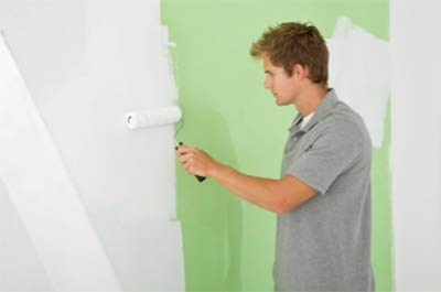 Painting a wall with a paint roller