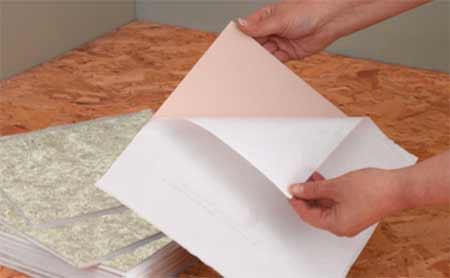 Peeling off back of self adhesive tile