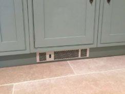 Plinth heater installed in kickboard