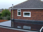 Repairing a Flat Roof with Fibre Glass Sheeting