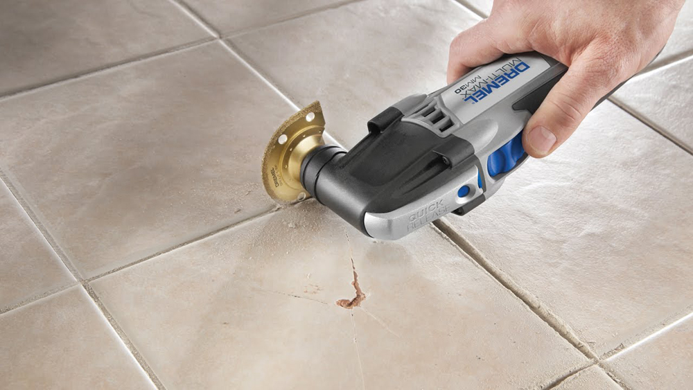 Replacing Grout Between Tiles And Raking Out For Regrouting Diy Doctor