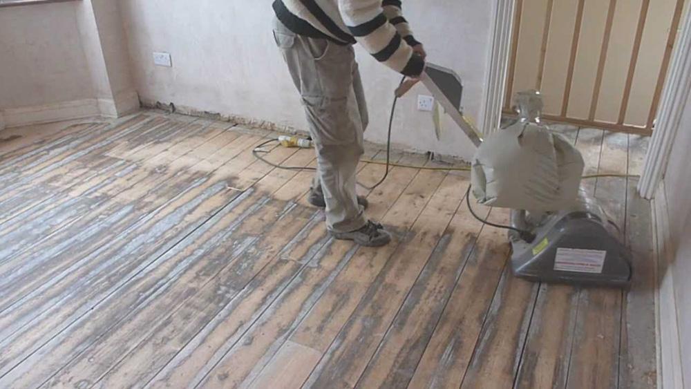 Sanding A Timber Floor Using A Floor Sander On Wooden