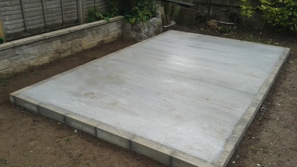 How to build a concrete shed base a diy guide to laying for Cheapest house foundation