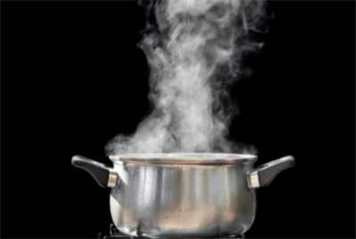 Steam rising out of boiling sauce pan