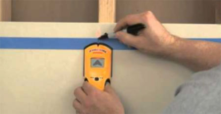 Using a stud detector to detect timber studs in walls