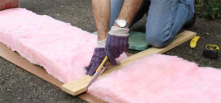 Cutting insulation with utility knife