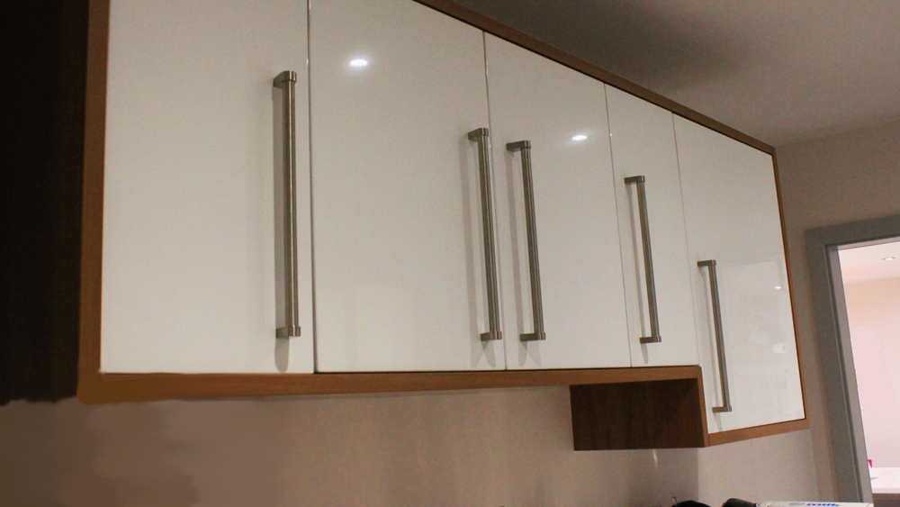Fit kitchen wall units diy guide to hanging kitchen wall for Kitchen boiler housing unit