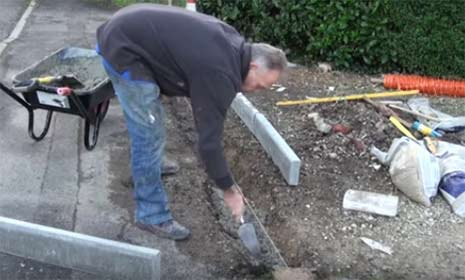 Lay concrete in base of trench