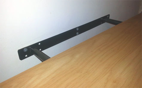 push the floating shelf onto the bracket