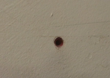 6mm hole with red wall plug