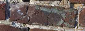 Brick damaged by the effects of freeze-thaw