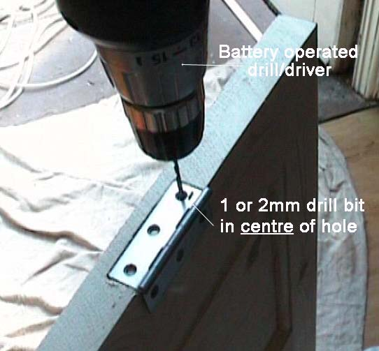 Drill driver screwing hinges down