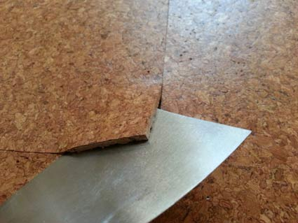 Levering up corner of cork tile