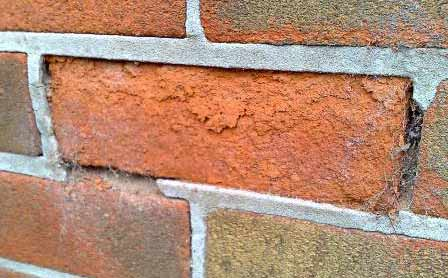 Frost damaged brick face