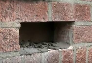 Mortar applied to base of hole