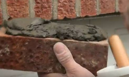 Mortar applied to top of replacement brick