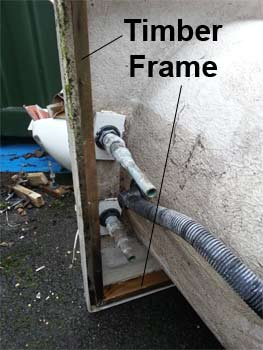 Timber support frame for acrylic bathtub around tap end