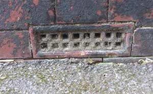 Debris and leaves can build up inside the air brick blocking air flow and causing damp conditions