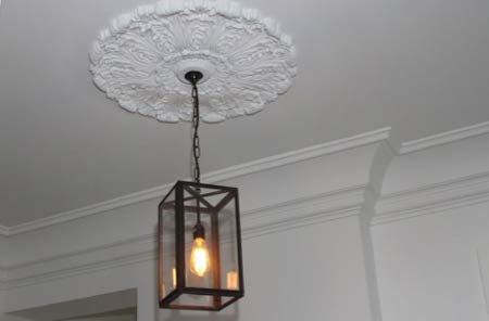 Ceiling rose around light fitting