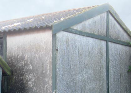 Outhouse with asbestos roof