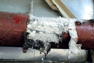 Pipe lagging with asbestos