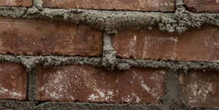 Fresh mortar in brick wall