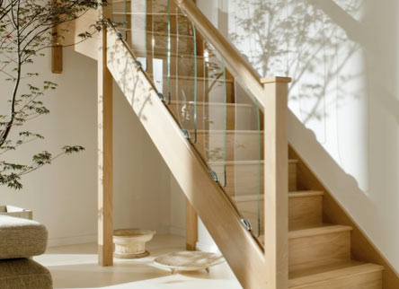 Wooden staircase and glass panelling