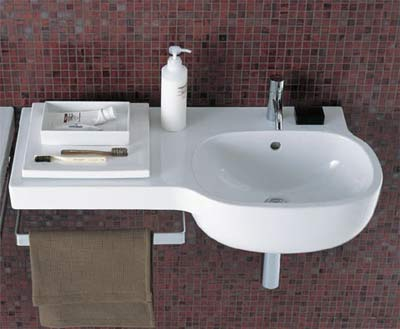 Asymmetrical basin in bathroom