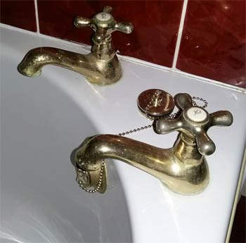 Brass effect bath taps