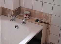 Wall tiled above bath
