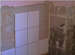 Laying tiles on wall
