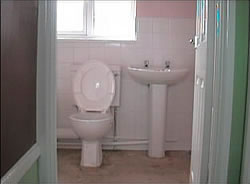 Completed bathroom install - sink and toilet installed and wall grouting completed