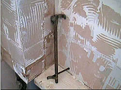 Bathroom with tiles removed
