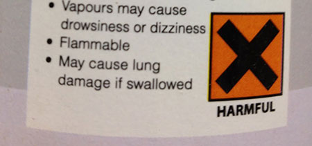 Warning label on can of paint