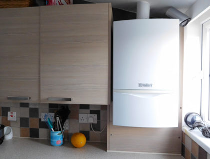 Wall mounted combi boiler in kitchen