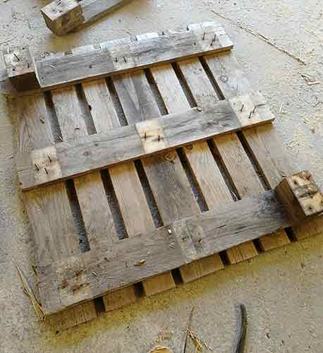 Base removed from pallet using car jack