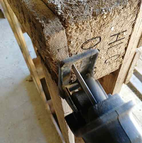 Cutting down through pallet block with reciprocating saw
