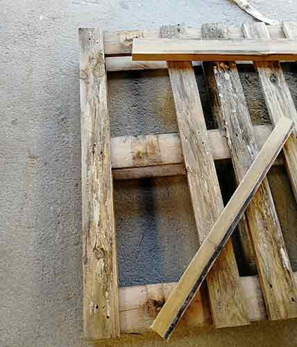Pallet slats removed with prying timbers