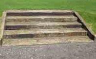 Railway sleeper steps formed in grass verge