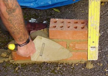 Level and plumb brickwork with a spirit level