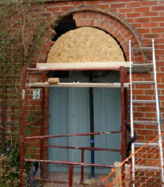 Brick arch being built with turning piece