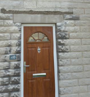Stone lintel with stitching above where support failed
