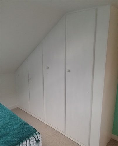 Finished and painted built-in sloping ceiling wardrobe