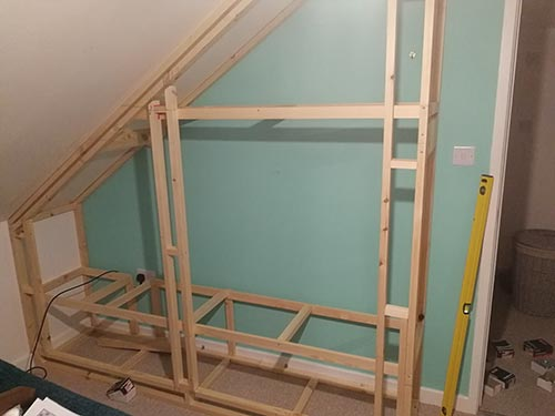 Fitted wardrobe frame installed