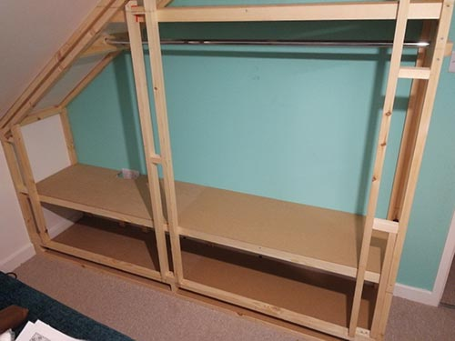 MDF fixed on to framework to form shelves