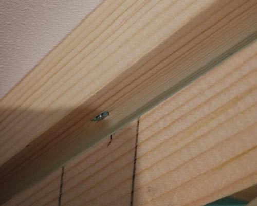 Front edge sloping timber fixed to ceiling