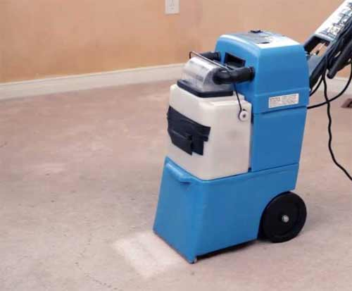 Deep cleaning a carpet with a carpet cleaner
